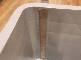 Detail foto van RVS duwbar Minipalletbox